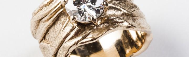 Remounting family diamond in custom setting.